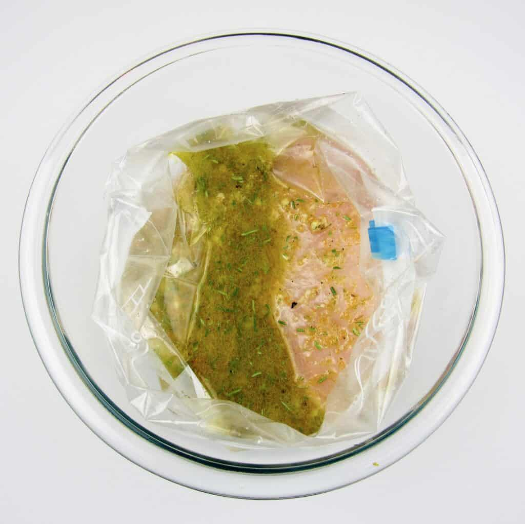 chicken breast with marinade in baggie