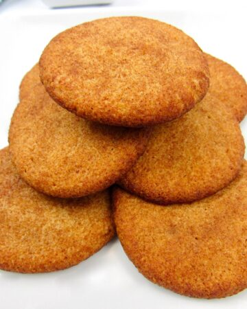 stack of snickerdoodle cookies on plate