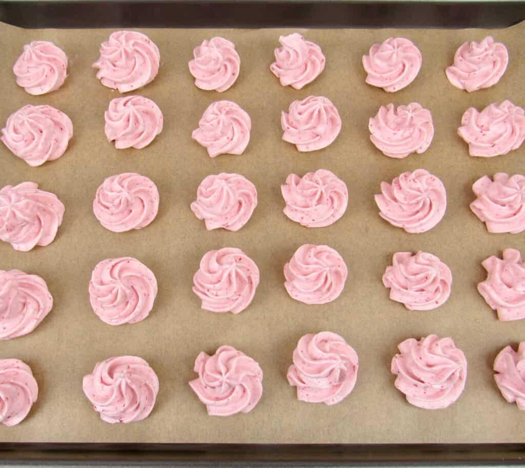 Keto Strawberry Meringue Cookies on baking sheet
