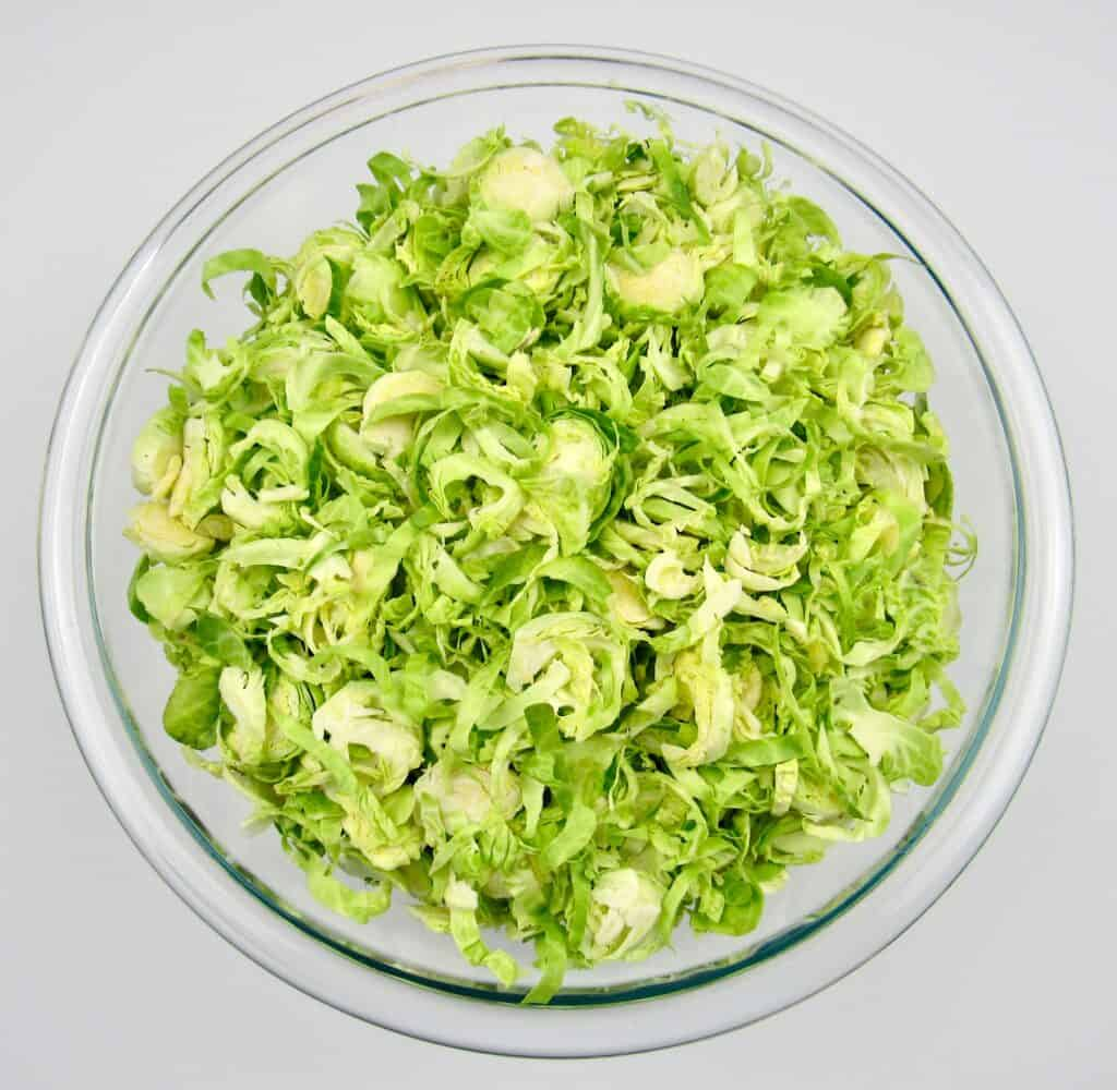 shredded Brussels sprouts in glass bowl
