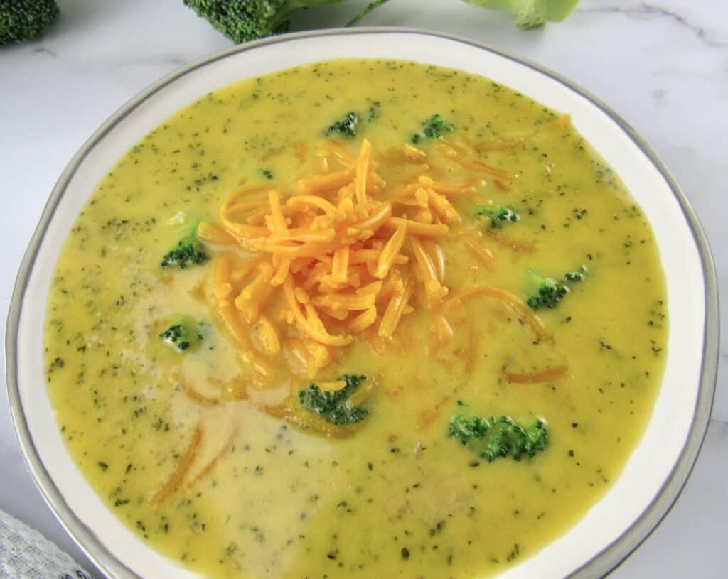 overhead view of broccoli cheese soup in bowl