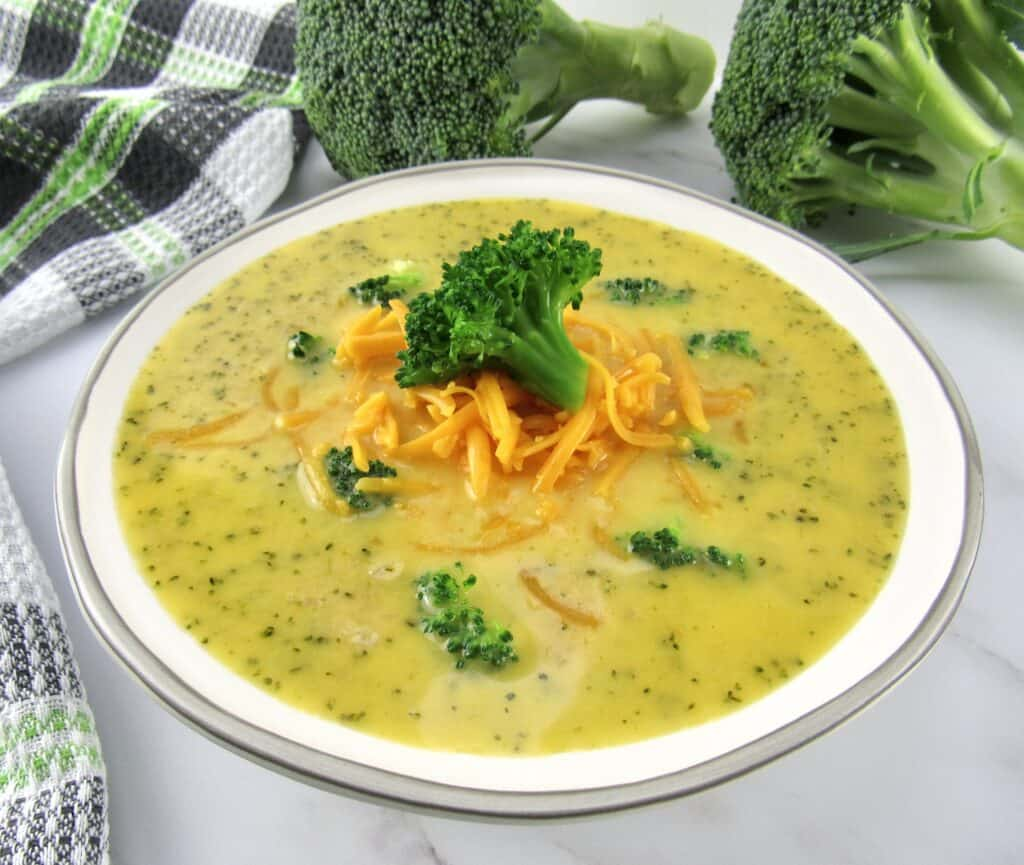 closeup view of broccoli cheese soup in bowl