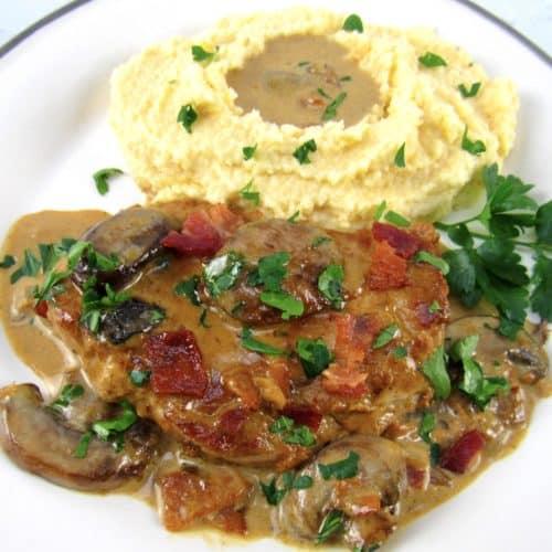 overhead view pork chop with mushroom gravy and mashed cauliflower