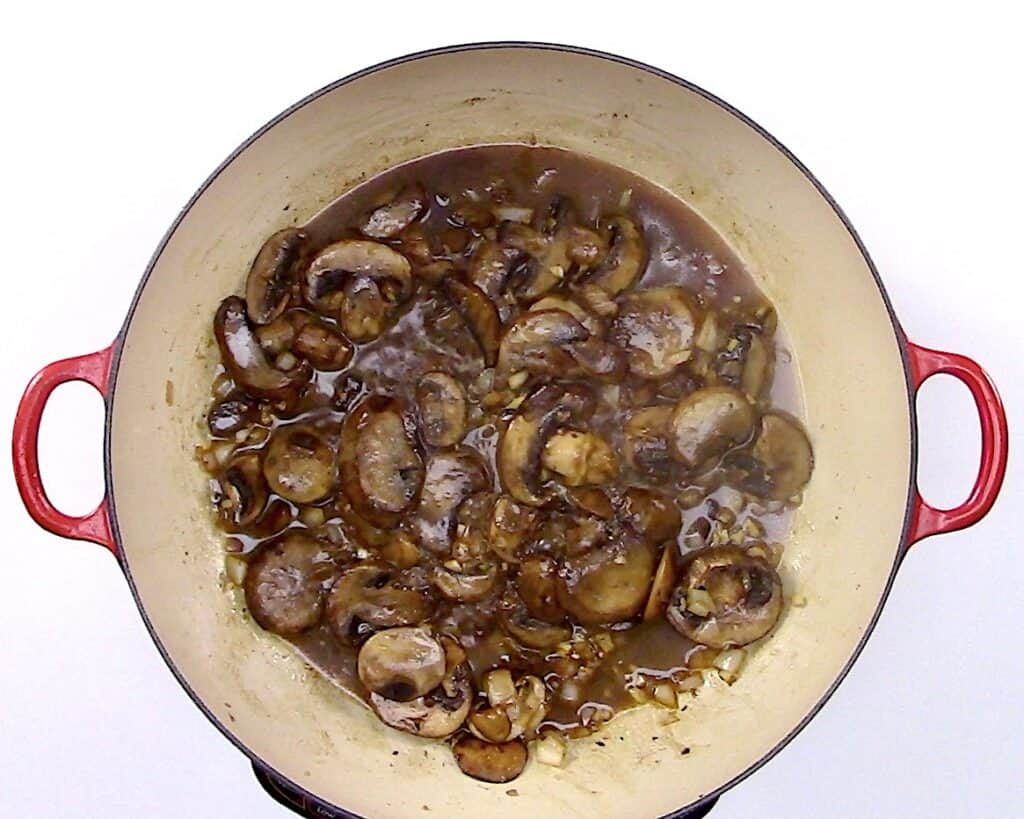 mushroom and wine cooking in skillet