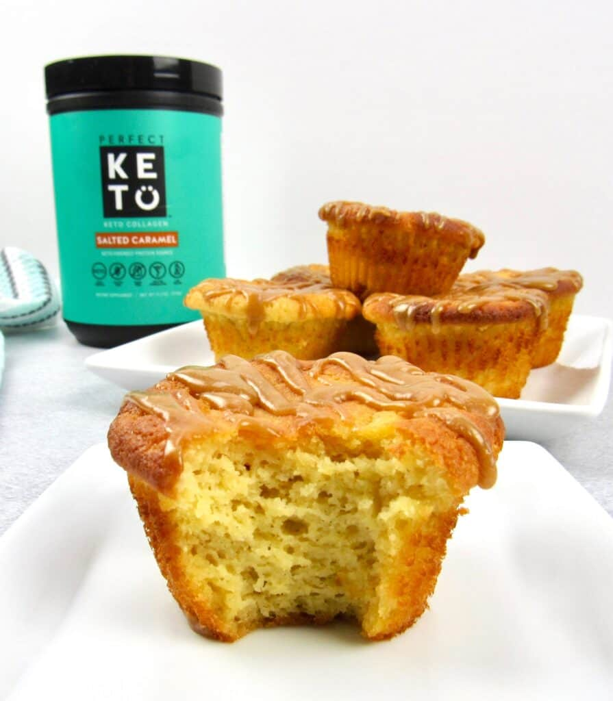 salted caramel muffins with Perfect Keto collagen container and bite taken out of muffin