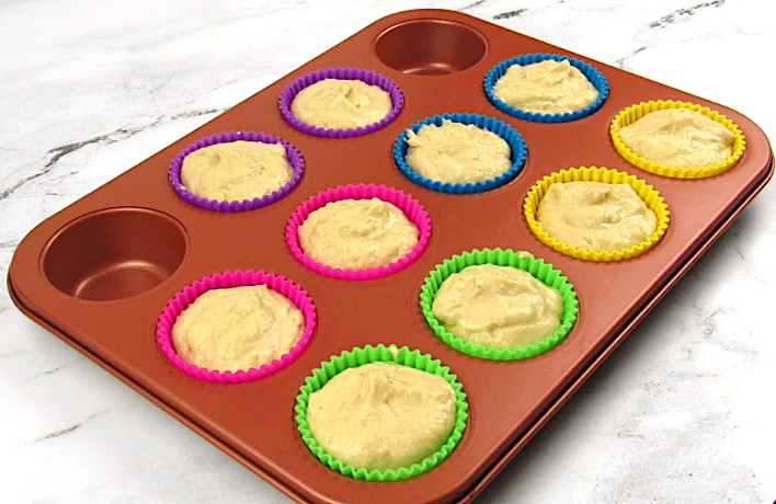muffin batter in silicon muffin cups