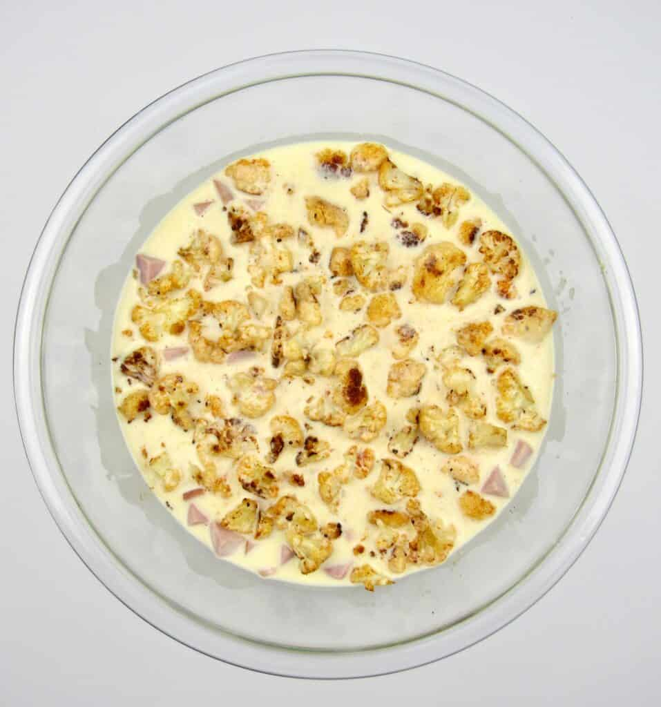 Roasted Cauliflower and Ham Casserole mixture in glass bowl