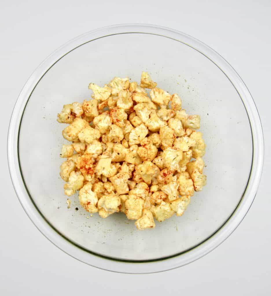 cauliflower with spices in glass bowl