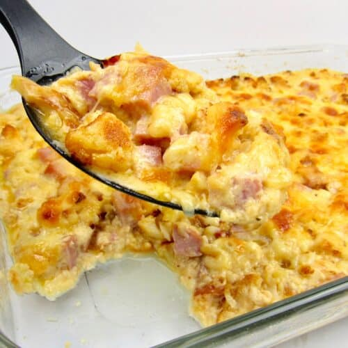 cauliflower and ham casserole with serving spoon ful