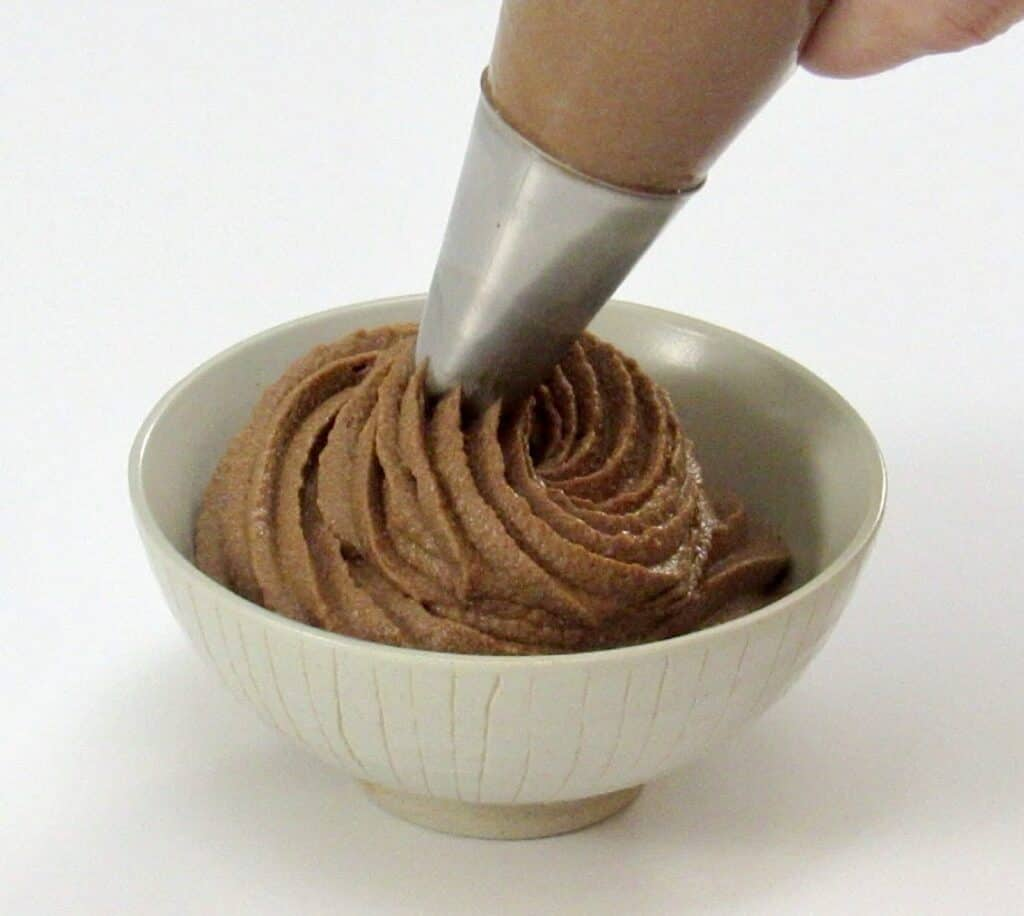 chocolate mousse being piped into a bowl