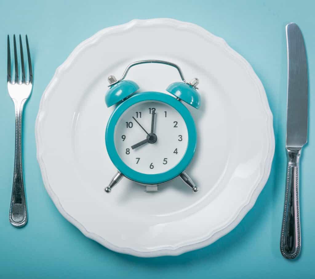 clock sitting on white plate