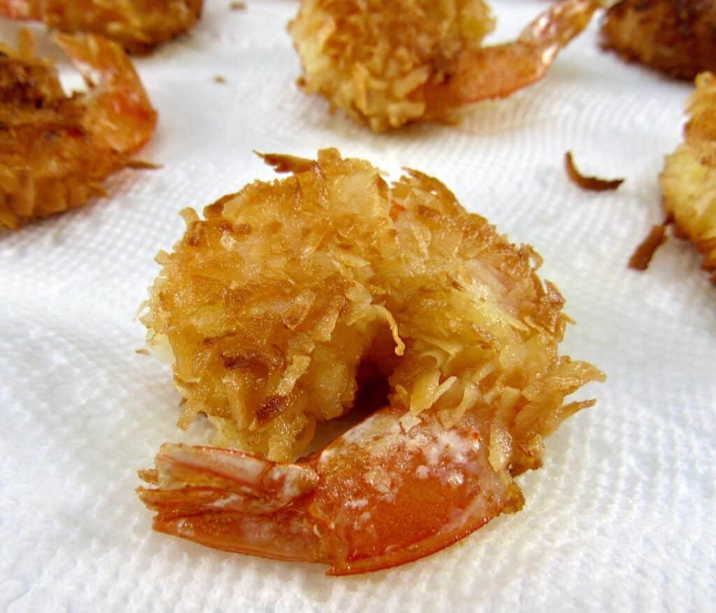fried coconut shrimp on paper towel
