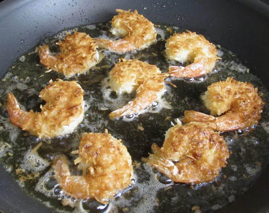 coconut shrimp frying in skillet