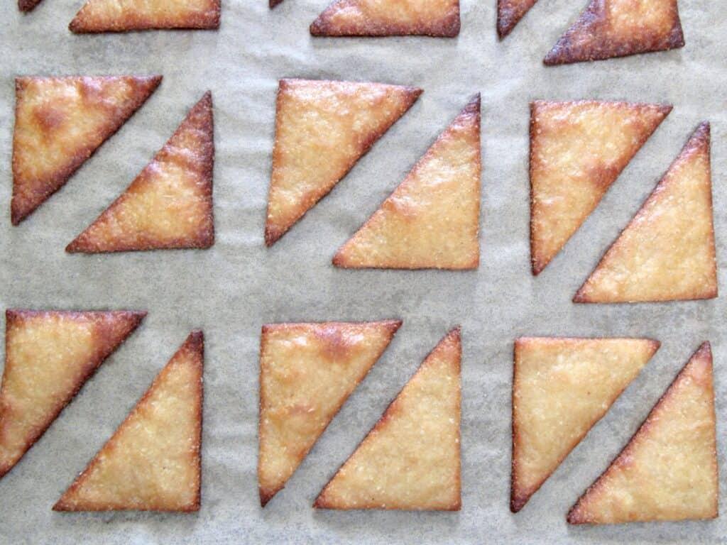 baked tortilla chips on baking sheet
