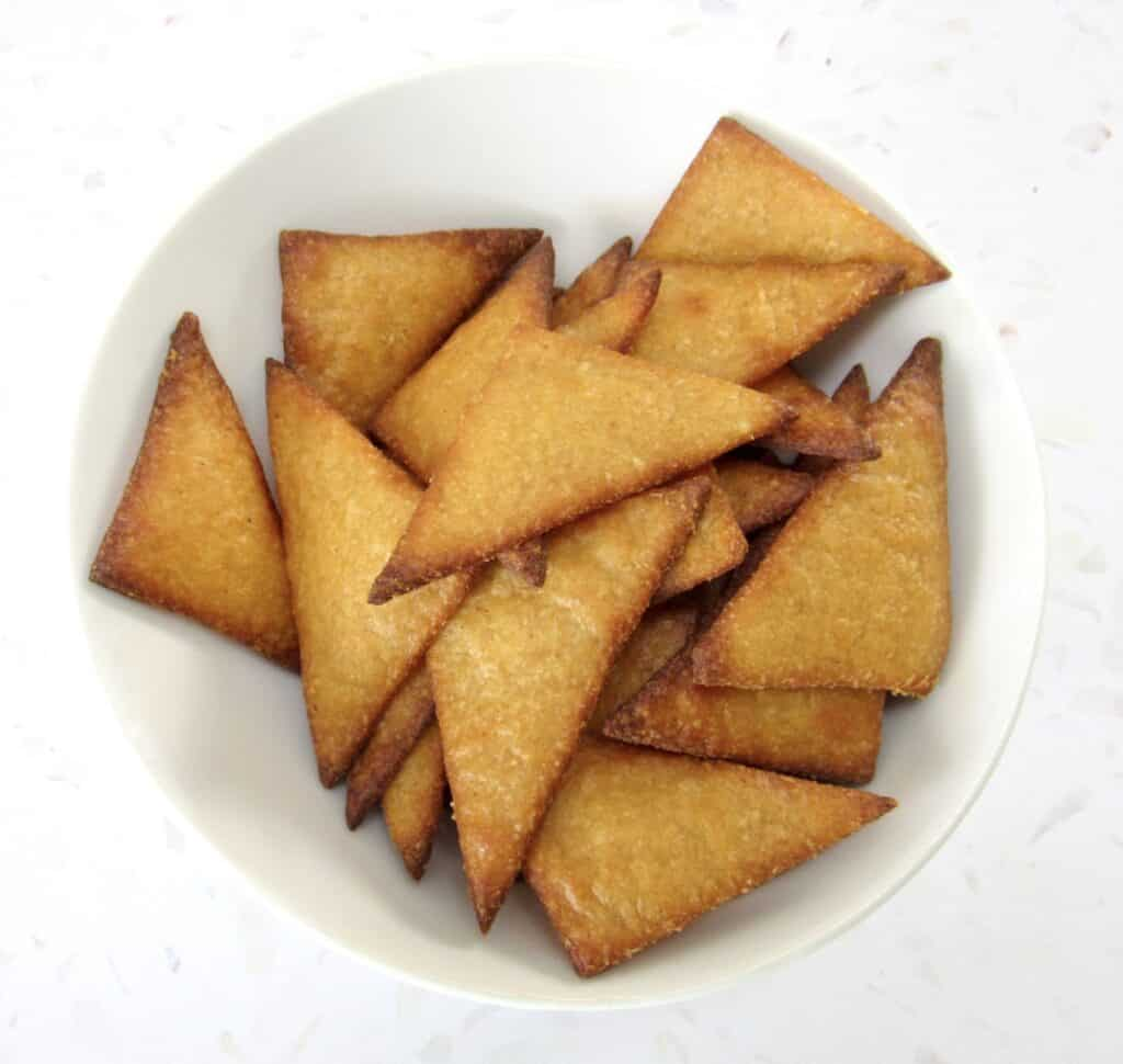 closeup of tortilla chips in white bowl unseasoned