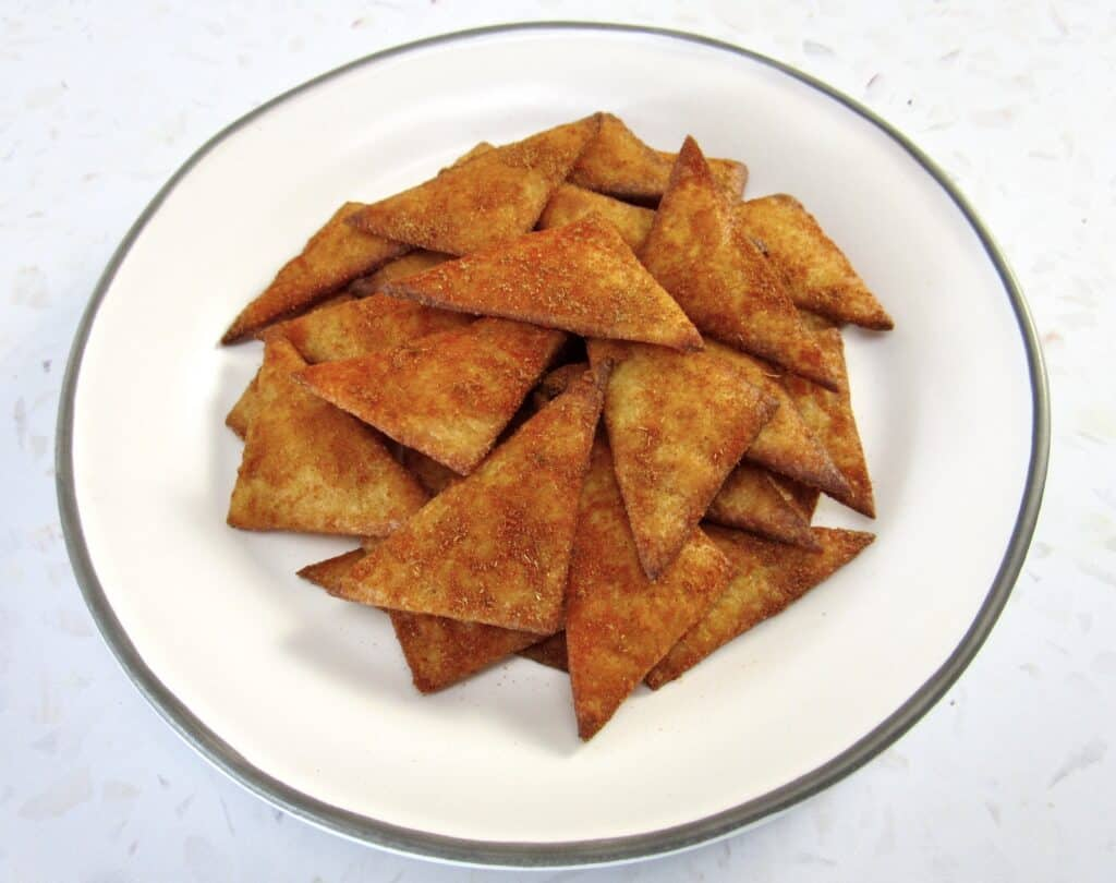 tortilla chips stacked on white plate