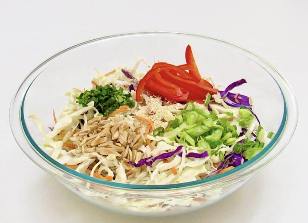 coleslaw ingredients in glass bowl unmixed
