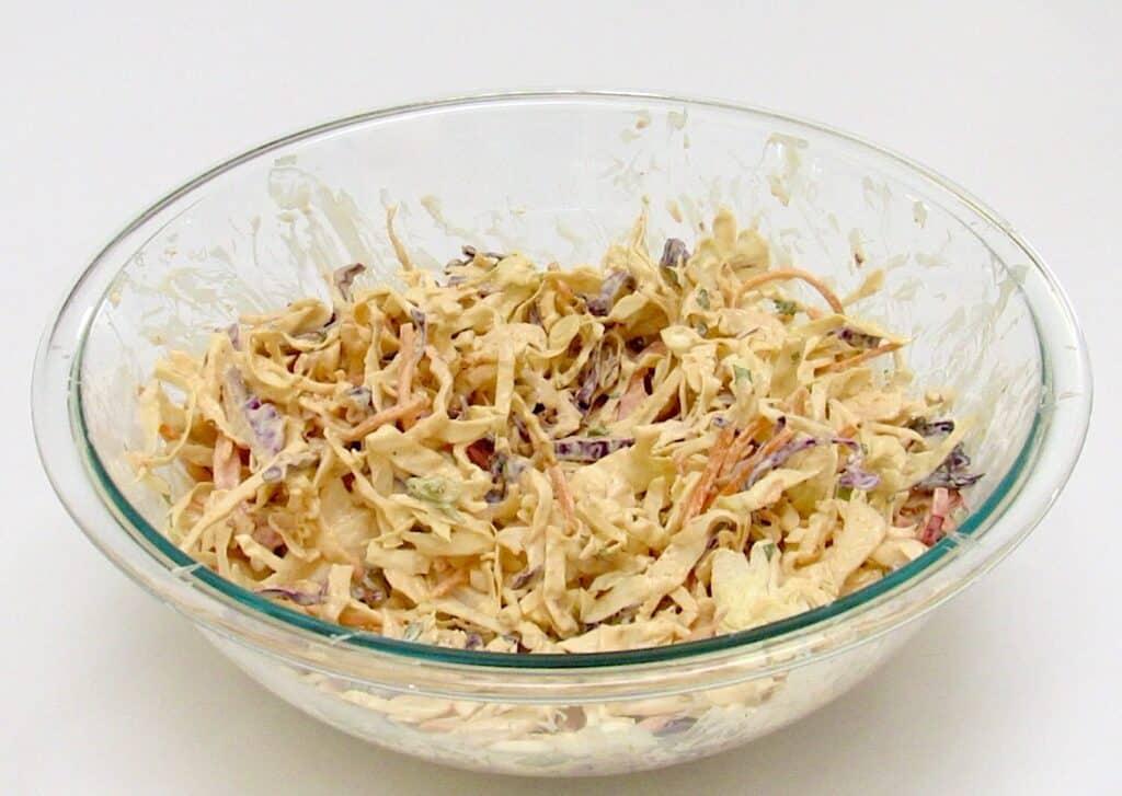 bang bang coleslaw in glass bowl