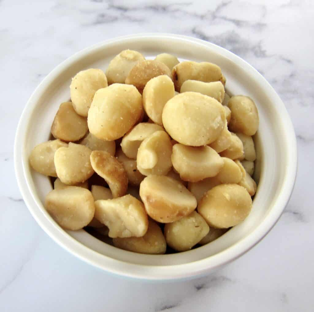 macadamia nuts in white bowl
