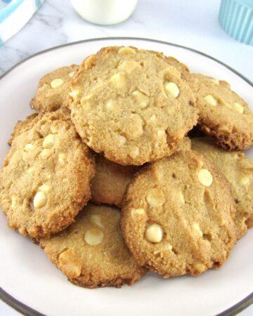 pile of white chocolate macadamia nut cookies on plate