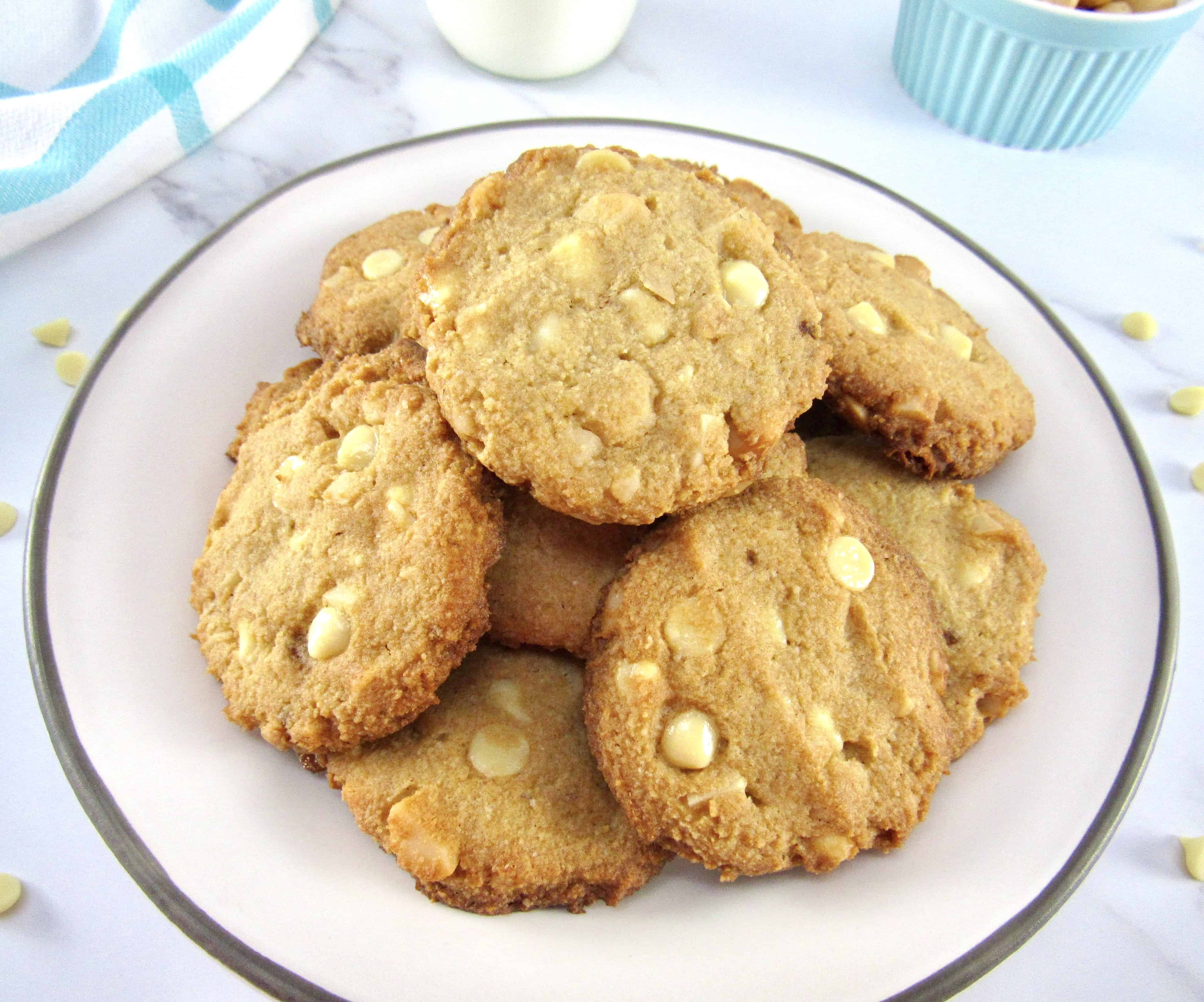 pile of white chocolate macadamia nut cookies on plate