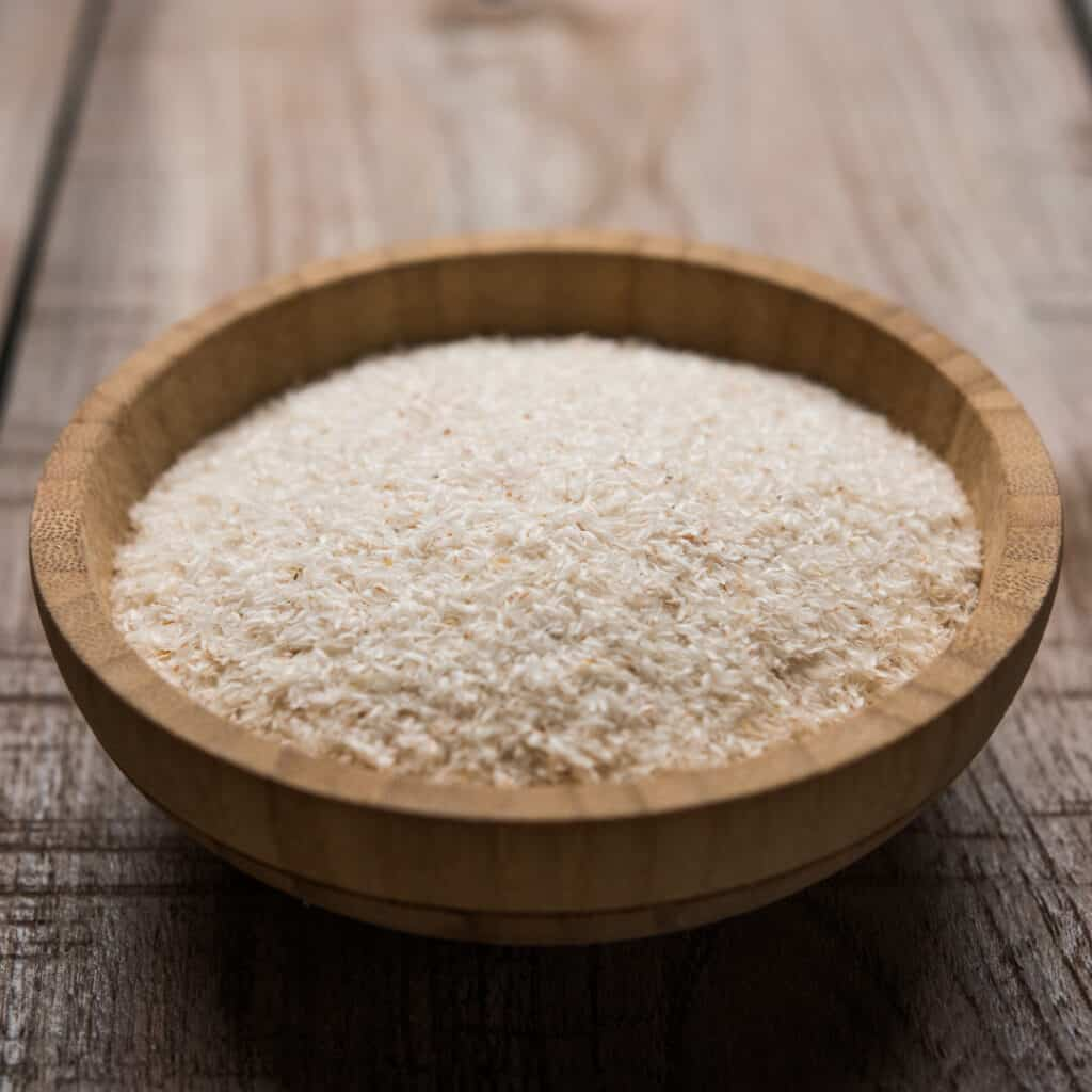 Psyllium Husk Powder in wooden bowl