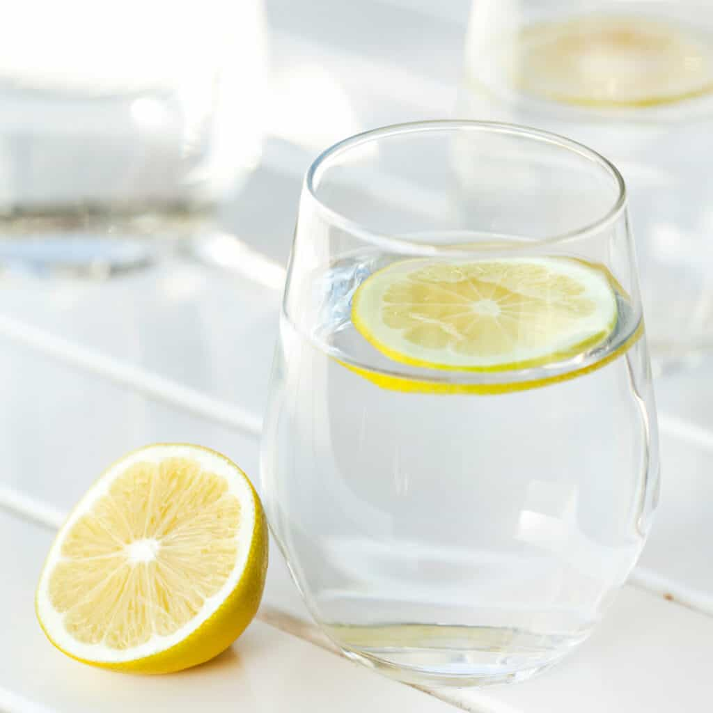 glass of water with slice of lemon