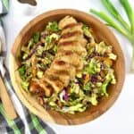 silced grilled chicken over cabbage salad