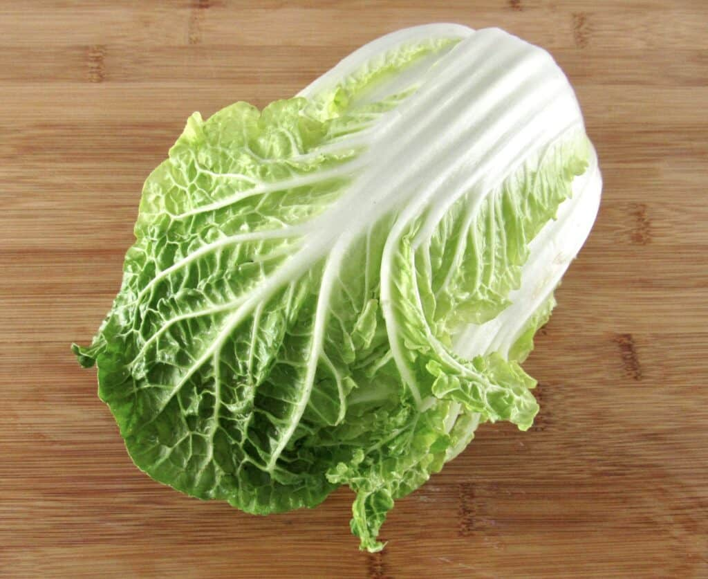 head of napa cabbage on cutting board