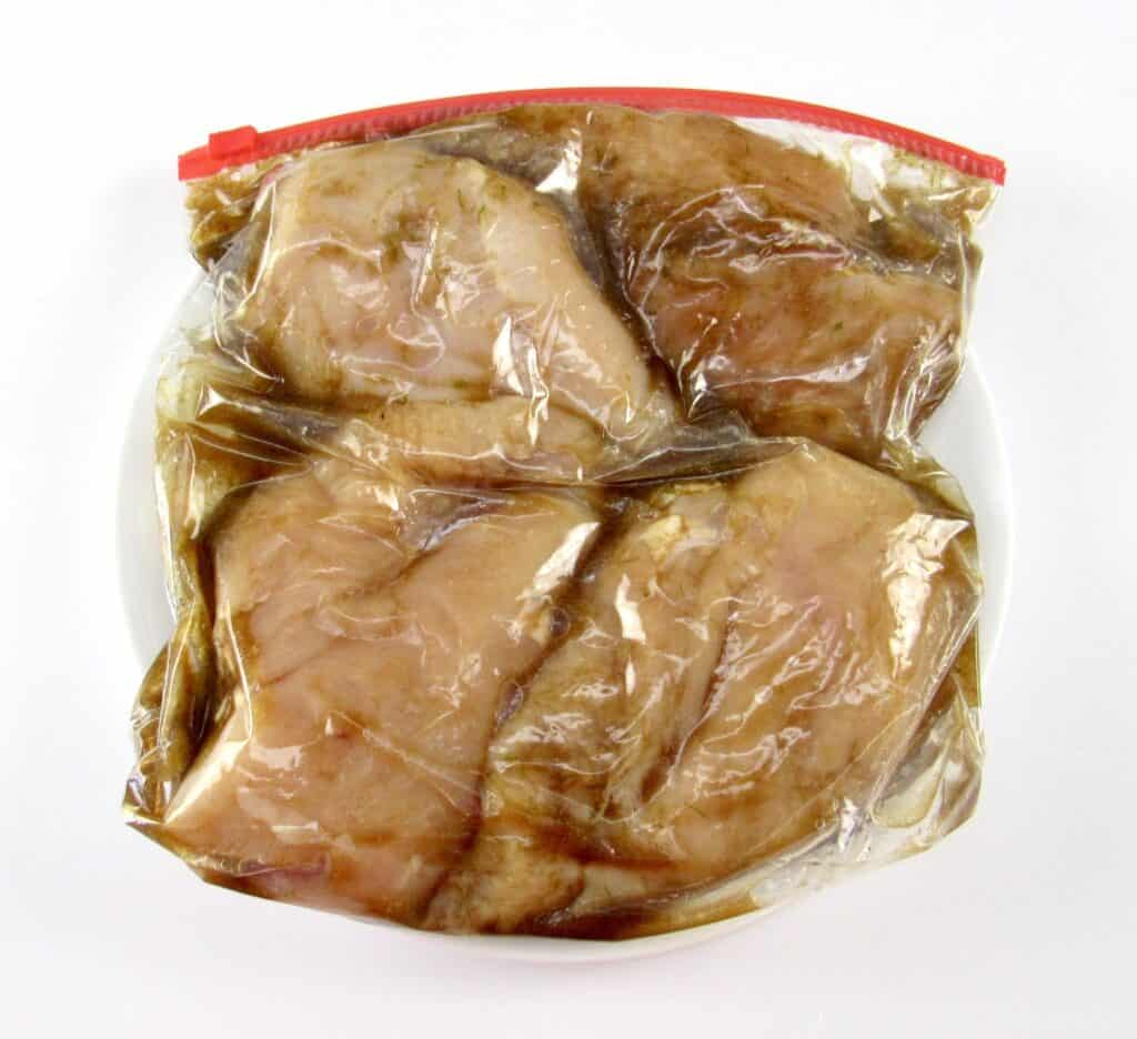 4 chicken breasts marinating in food baggie