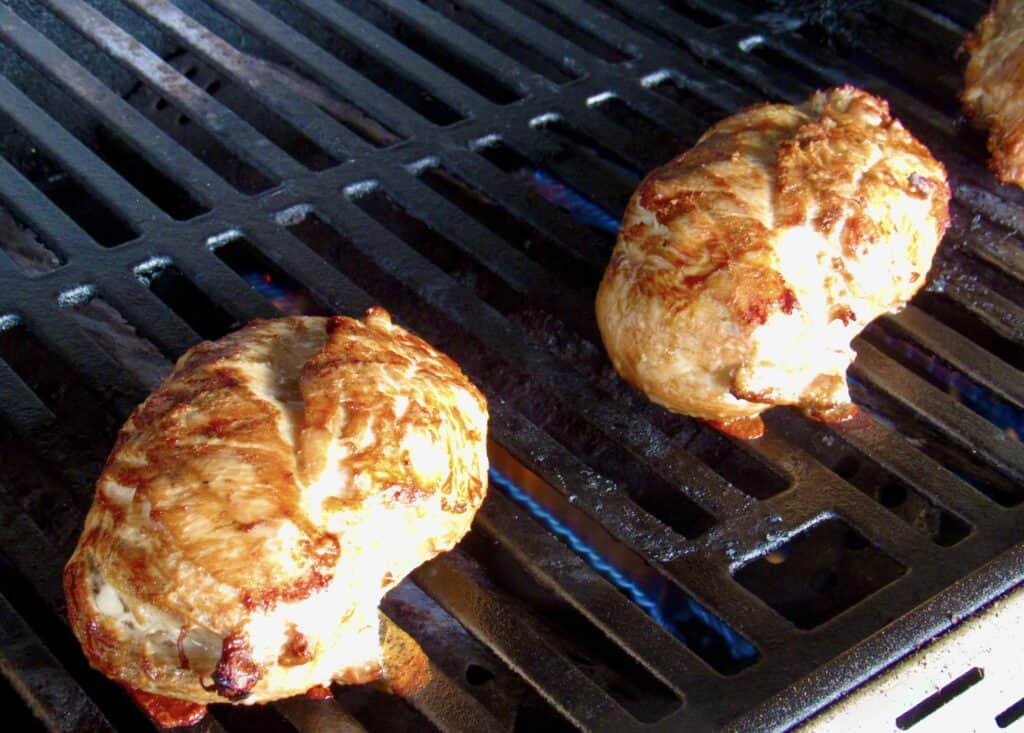 2 pieces of chicken breasts on grill