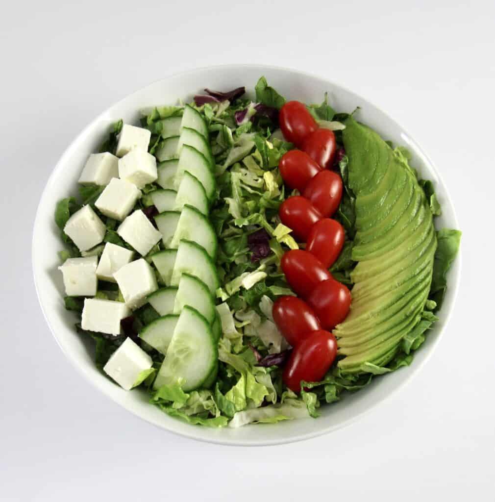green salad with veggies on top