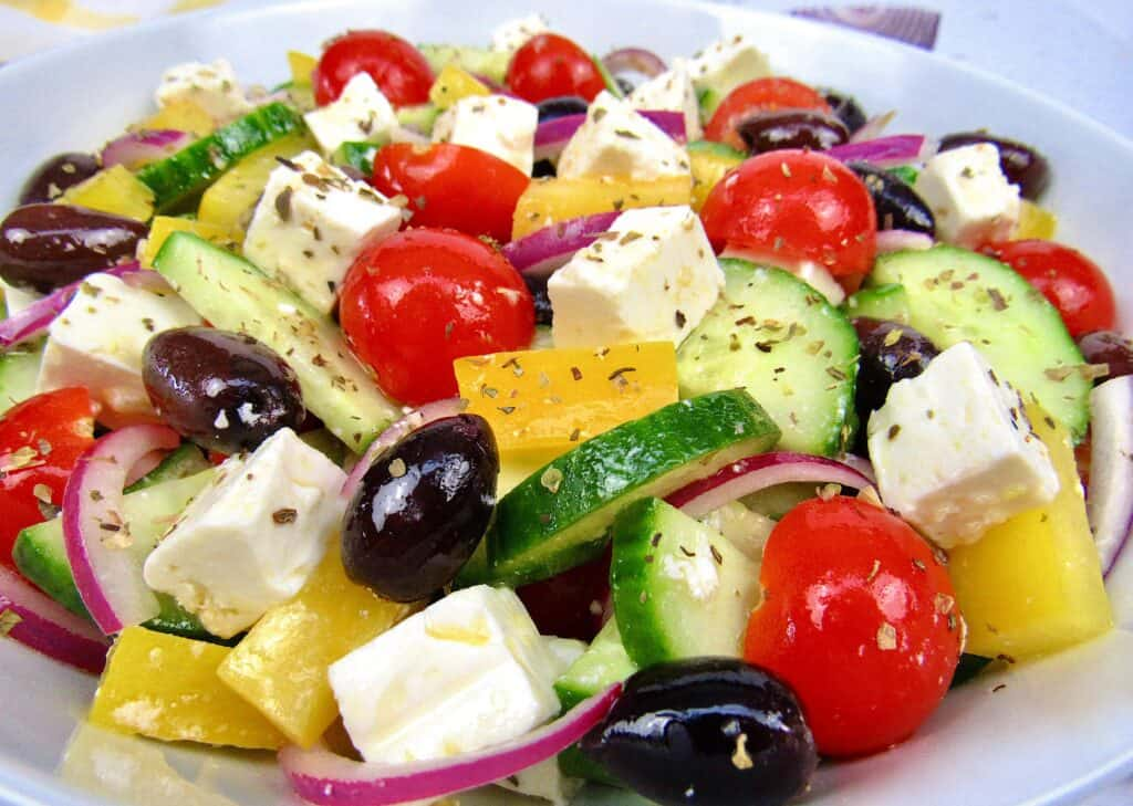closeup of greek salad with oregano on top