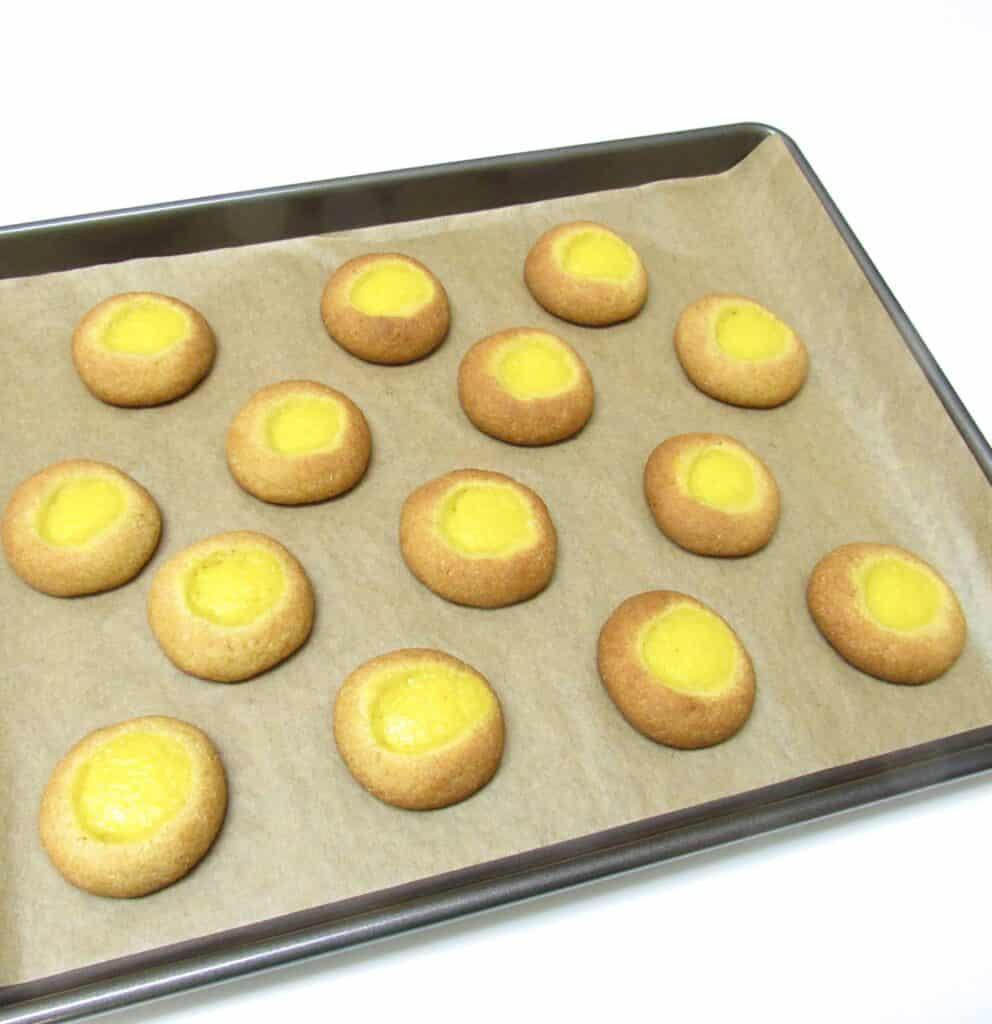 baked thumbprint cookies on baking sheet