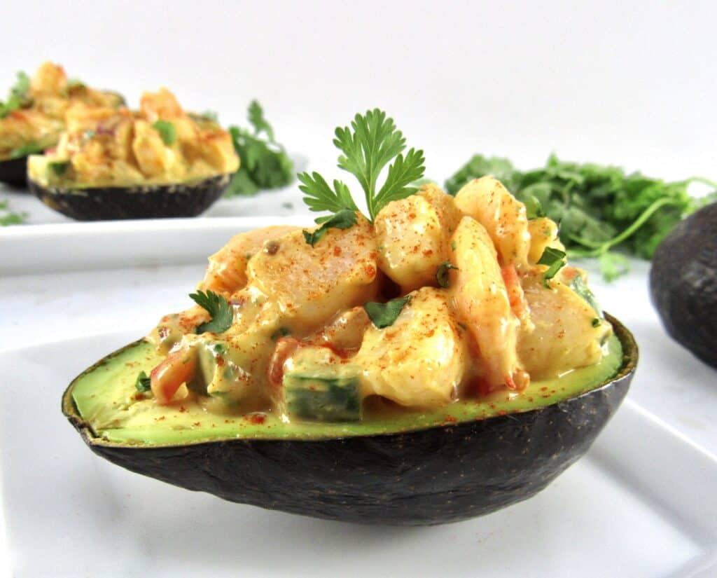 closeup shrimp salad in ½ avocado