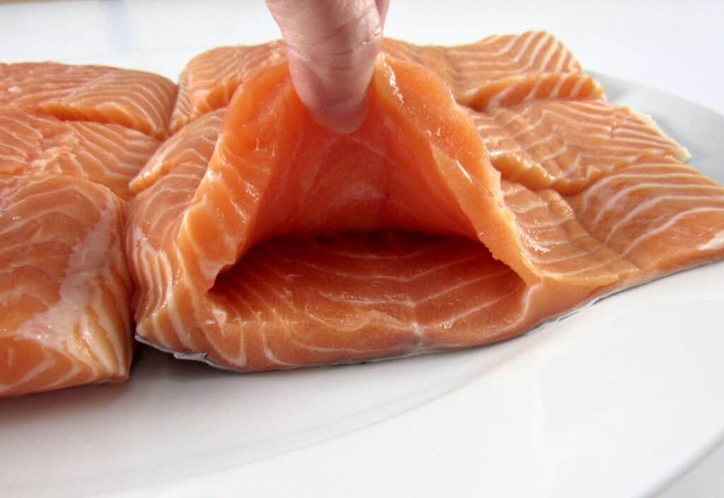 salmon cut holding it open