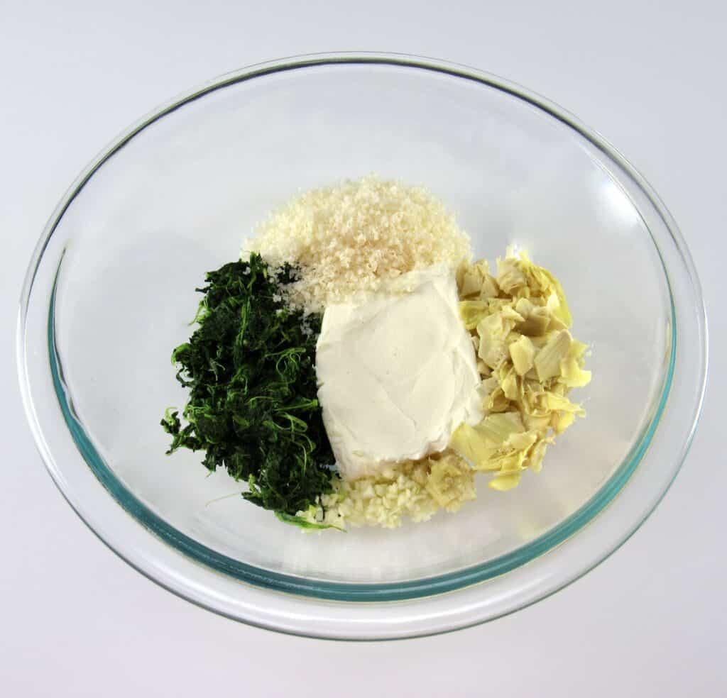 spinach artichoke filling in glass bowl