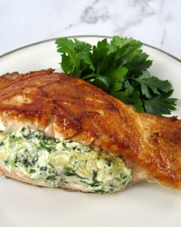 stuffed salmon on plate with parsley