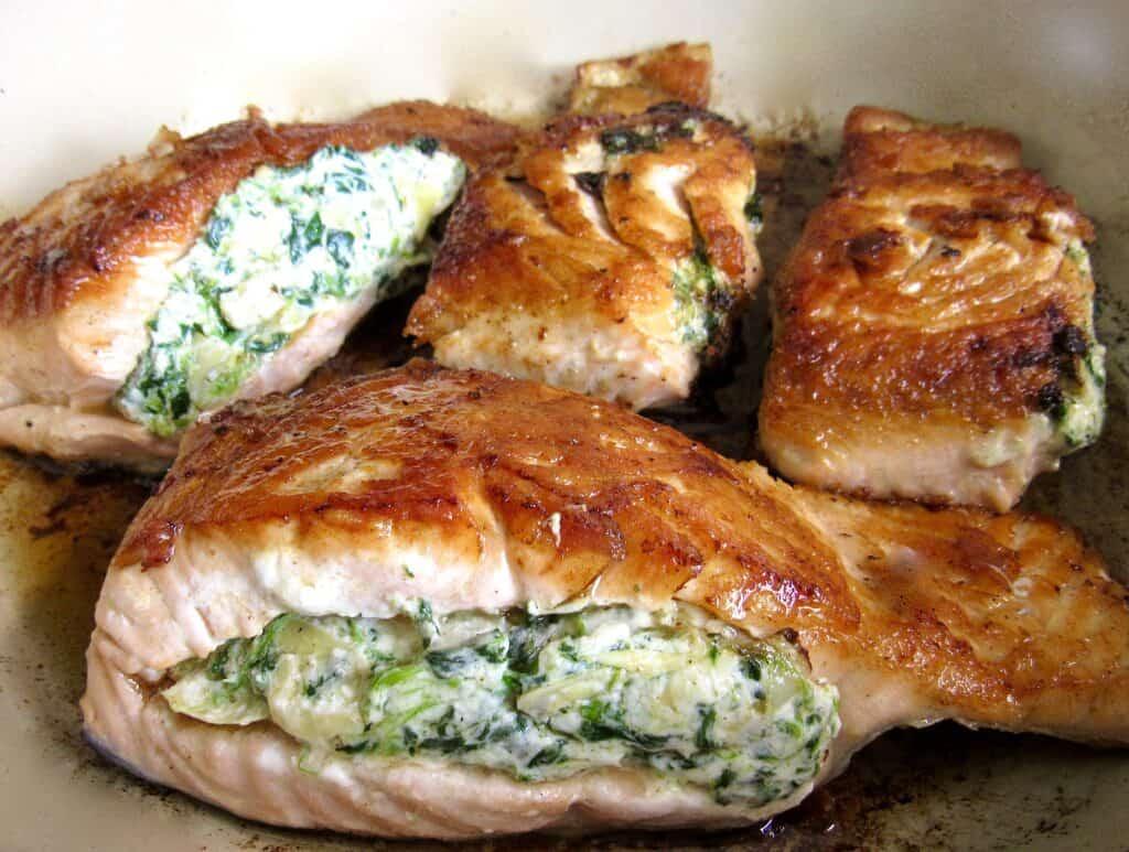 stuffed salmon frying in skillet