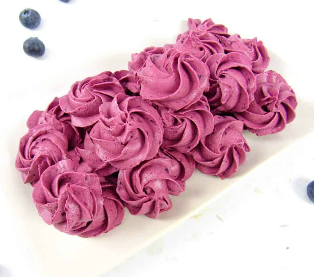 blueberry fat bomb rosettes on beige plate