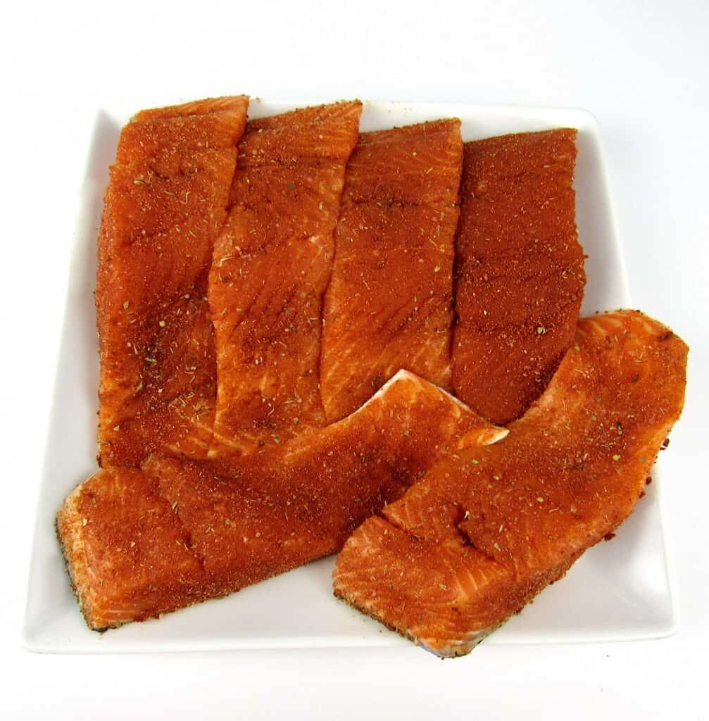 6 pieces of salmon with blackened seasoning over the tops