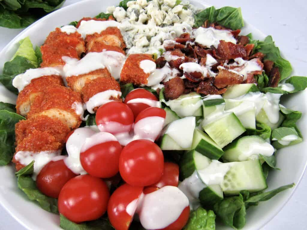 closeup overhead view of buffalo chicken salad with blue cheese dressing