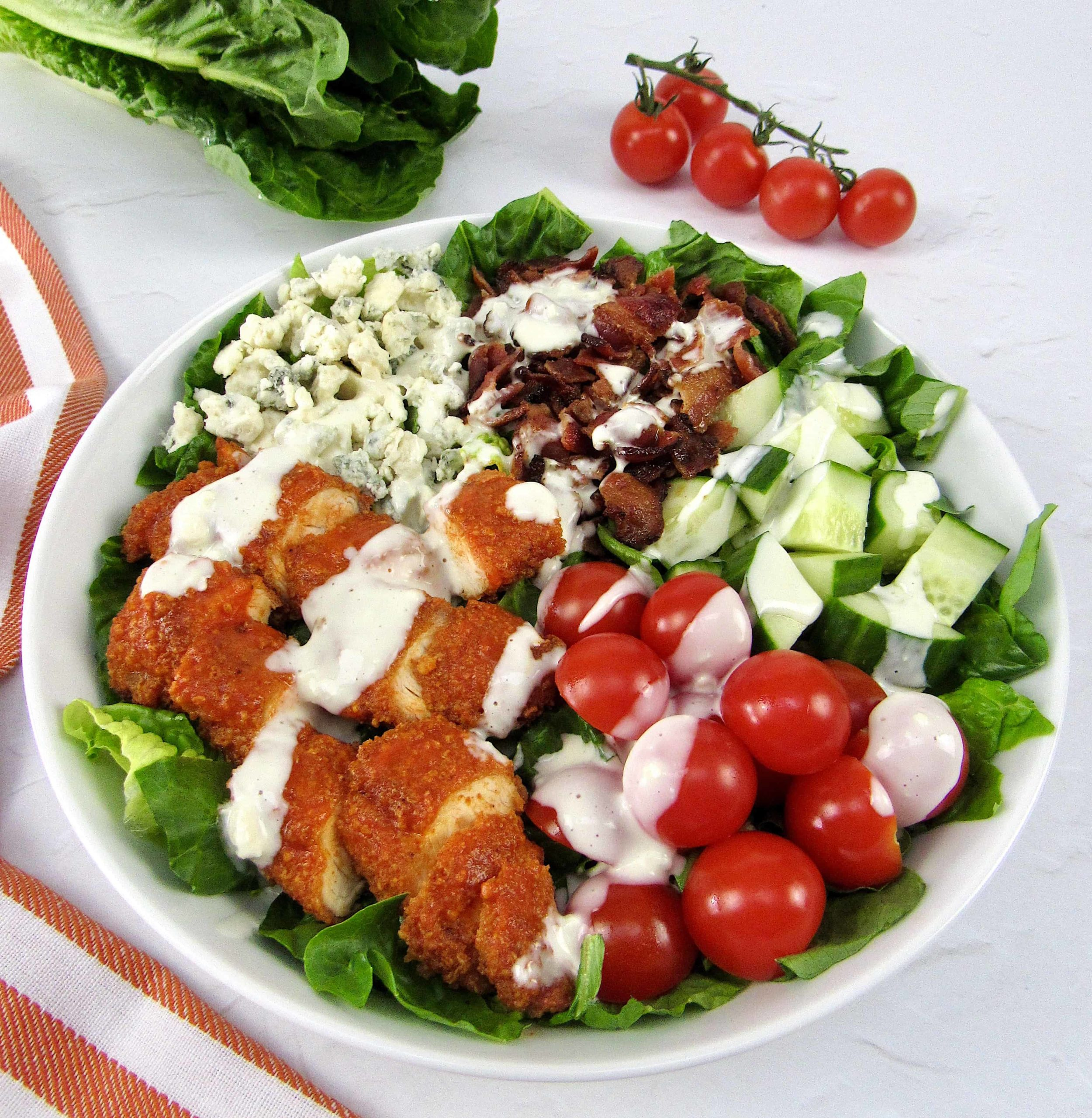 buffalo chicken salad with blue cheese on top