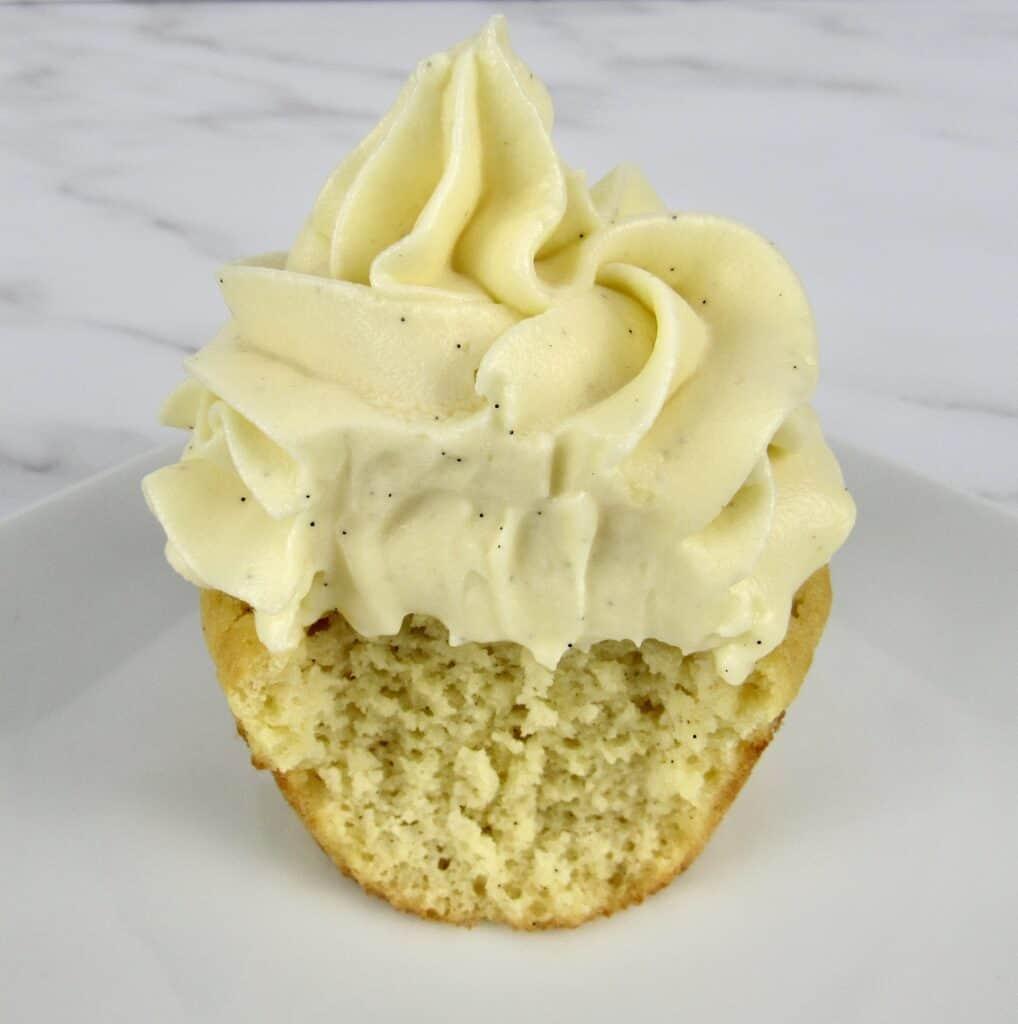 vanilla cupcake with bite taken out