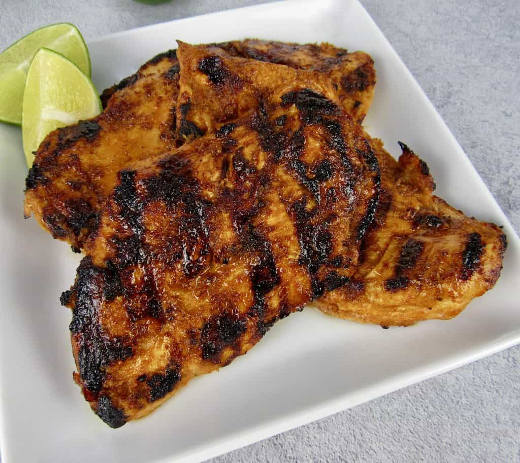 closeup overhead view of closeup of grilled chipotle lime chicken on plate