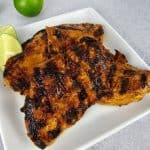 overhead view of closeup of grilled chipotle lime chicken on plate
