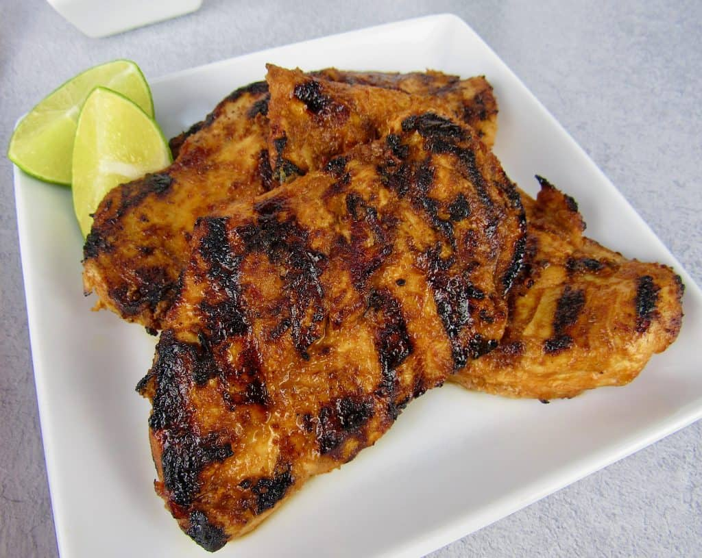 closeup of grilled chipotle lime chicken on plate