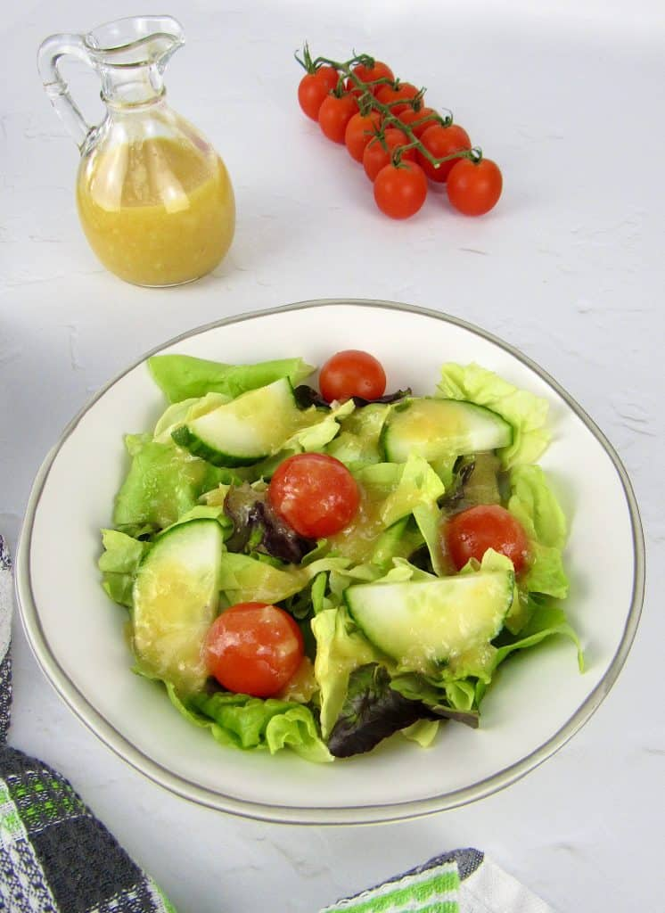 overhead view of salad with apricot dressing on top