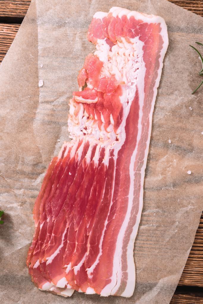 raw bacon on cutting board