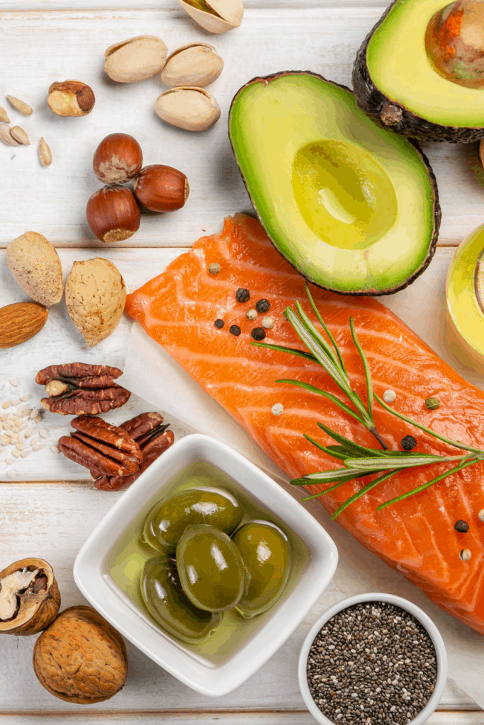 Healthy Fats for Keto on white wood background